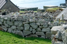 Modern clothesline in stone age St. Kilda off the northwest coast of Scotland.