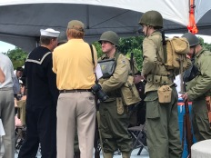 They helped the D-Day vets stand front and center to be recognized.
