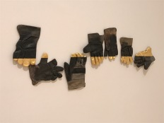 """Consonance"" 1992, found gloves and gold leaf."