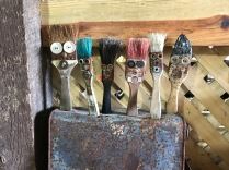 Paint brushes are wide-eyed and all stuck-up.