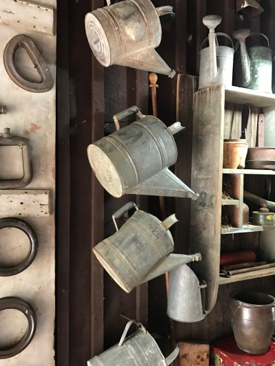 Retired watering cans.